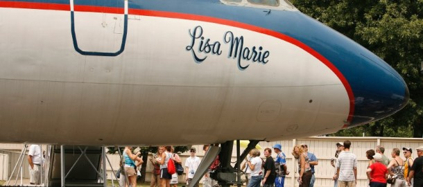 "Fans line up to enter Elvis' private plane named the ""Lisa Marie"" near Graceland in Memphis, Tennessee"
