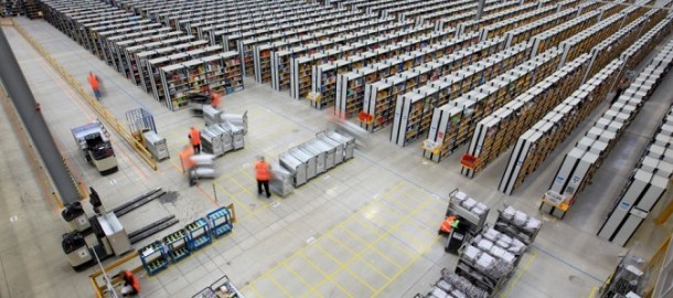 23/11/12...At first glance this new warehouse looks similar to any one of the seven giant Amazon depots in Britain. But take a closer look at the giant Fulfillment Centre - as it's called - and you'll notice that there isn't a single book anywhere in sight...The 700,000 sq. ft. site in Rugeley, Staffordshire, is however stuffed full of toys, games, and electronic equipment. ..Photographed here for the first time, the Rugeley site opened last September - the first one of the company's specialist fulfillment centres not to sell books. Staff there are working flat-out processing Christmas orders. The company has employed an extra 10,000 members of staff across Britain to cope with the surge in Christmas orders...At the Christmas 2011 peak, Amazon's UK fulfilment centres shipped over 2.1m units in one 24 hour period - a total of 1,124 tones of goods - which meant a delivery truck left a fulfillment centre once every two minutes and 45 seconds...Online retailers name today 'Black Friday' as it marks the beginning of the Christmas rush - which is expected to peak this year on December 3rd -  'Cyber Monday'...Amazon first went online in the UK in 1998 selling books. It soon became the world's largest bookstore before becoming the biggest online retailer when it began selling other items....All Rights Reserved - F Stop Press  - T: +44 (0)1335 300098..Local copyright law applies to all print & online usage. Fees charged will comply with standard space rates and usage for that country, region or state...