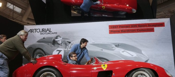 People install a 1957 Ferrari 335S Spider Scaglietti car valued at more than 32 millions of euros on February 2, 2016 at the Retromobile show in Paris, as part of a sports car auction scheduled February 5.  / AFP / JACQUES DEMARTHON