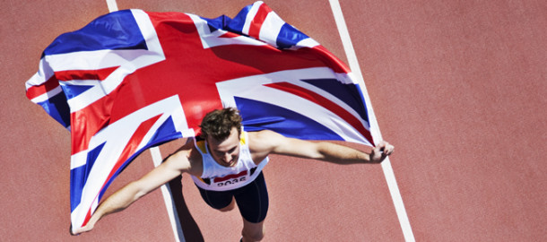 Runner celebrating with British flag on track
