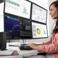 Woman seated at desk with headset on, using Dell Wyse Quad-Display thin client (7020), with four Dell P2714H Monitors and Dell KM714 keyboard and mouse.