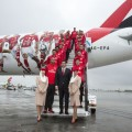 PRT- MAY052016-   The Sport Lisboa e Benfica football team poses for a photograph in front of the Emirates Airline Boeing 777 that features the images of players Julio Cesar, Jonas, Gaitan, Luisão, Salvio and Samaris  on its side, today, at the Lisbon airport. Photo by Rui Coutinho