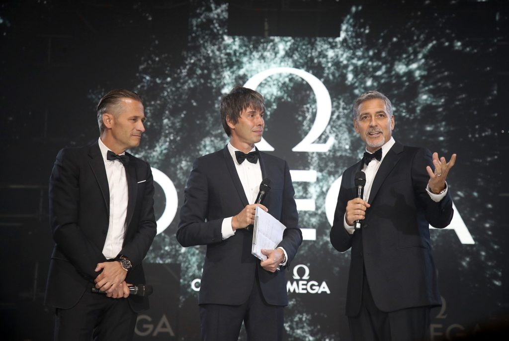 LONDON, ENGLAND - APRIL 26: (L-R) Omega President and CEO Raynald Aeschlimann, Prof. Brian Cox and George Clooney on stage at the OMEGA 'Lost In Space' dinner to celebrate the 60th anniversary of the OMEGA Speedmaster, which has been worn by every piloted NASA mission since 1965, at Tate Modern on April 26, 2017 in London, England. (Photo by Mike Marsland/Mike Marsland/Getty Images for OMEGA) *** Local Caption *** Raynald Aeschlimann; Brian Cox; George Clooney