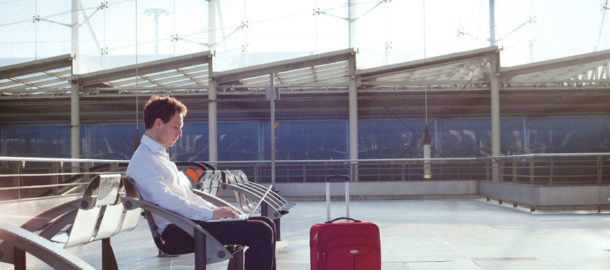 53102416 - businessman waiting in the airport with laptop